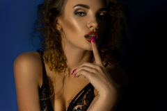 Close up portrait of gorgeous lady with curly hair and beautiful make up Stock Photo