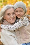 Close up portrait of grandmother and granddaughter outdoors stock photos