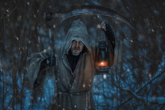 Close-up portrait of a grim reaper with scythe. Stock Photo
