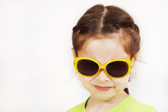 Close up portrait of a grinning cute little girl Stock Photos
