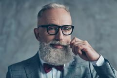 Close up portrait of grinning old-fashioned trendy elegant wealthy professional flirty trendsetter hipster grandpa sharp dressed stock photo