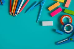 Group of colorful stationary set. Close up portrait of group of colorful stationary set on pastel background with copy space Royalty Free Stock Photography