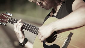 A close up portrait of a guitarist playing chords-based melody stock video footage