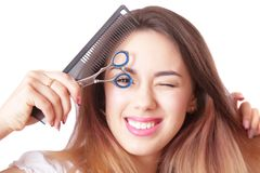 Close-up portrait of a hairdresser with scissors Royalty Free Stock Photo