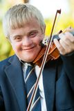 Close up portrait of handicapped boy with violin. Royalty Free Stock Image