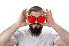 Close-up portrait of handsome bearded man closing eyes by red h stock images