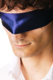 Close-up portrait of a handsome blindfold man Royalty Free Stock Images