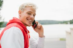 Close up portrait of handsome blond smiling man wlaking in the p Royalty Free Stock Photo