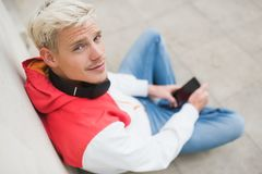 Close up portrait of handsome blond smiling man wlaking in the p Royalty Free Stock Images