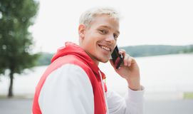 Close up portrait of handsome blond smiling man wlaking in the p Stock Photography