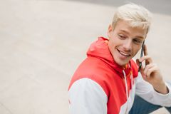 Close up portrait of handsome blond smiling man wlaking in the p Royalty Free Stock Photos
