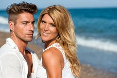 Close up portrait of handsome couple on beach. Stock Photography