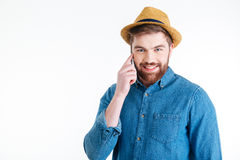 Close-up portrait of a handsome man talking on mobilephone Royalty Free Stock Photos