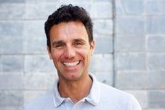 Close up portrait of a handsome older man smiling Stock Images