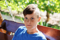 Close-up portrait of a handsome teen boy. Outdoors Royalty Free Stock Photo