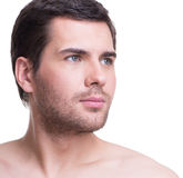 Close-up portrait of handsome young man. Close-up portrait of handsome young man looking sideways - isolated on white stock image