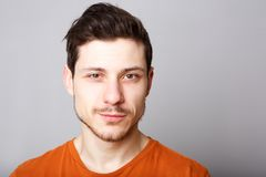 Close up handsome young man against gray background. Close up portrait of handsome young man against gray background Royalty Free Stock Photos
