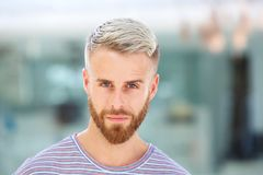 Close up handsome young man with beard staring. Close up portrait of handsome young man with beard staring Royalty Free Stock Photos