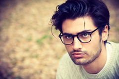 Close-up portrait of a handsome young man with glasses Royalty Free Stock Images
