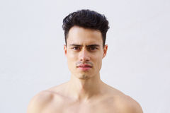 Close up portrait of a handsome young shirtless man Stock Images