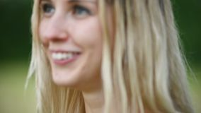 Close-up portrait of a happy attractive Caucasian blonde girl with wet hair during a rain on the nature outdoor on a. Wheat field. Happiness hope flirting and stock footage