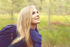 Close-up portrait of a happy, beautiful blond girl walking in fo Royalty Free Stock Photos
