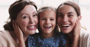 Close up portrait of happy beautiful three female generations family.