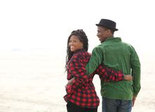 Close up portrait of a happy black couple. Walking not he beach royalty free stock image