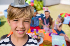 Close up portrait of happy boy with friends in background Royalty Free Stock Image