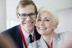 Close-up of portrait of happy business people in convention center Stock Photo
