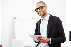 Close-up portrait of a happy businessman holding pc tablet Stock Photo