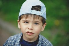 Close up portrait of a happy child outdoor. Child boy portrait close up in nature royalty free stock images
