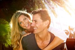 Close up happy couple in love outside in embrace. Close up portrait of happy couple in love outside in embrace Royalty Free Stock Photo