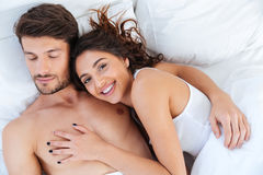 Close-up portrait of a happy couple sleeping and hugging Stock Images