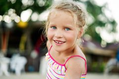 Close up portrait of happy cute little blonde girl. Smiling blonde child on summer. adorable kids, childhood, emotions concept stock photography