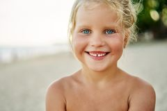 Close up portrait of happy cute little girl. Smiling blonde child on summer. adorable kids, childhood, emotions concept royalty free stock photos