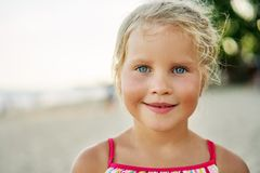 Close up portrait of happy cute little girl. Smiling blonde child on summer. Adorable kids, childhood, emotions concept royalty free stock images