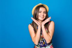 Portrait of a happy excited young woman in beach hat with smile looking at camera isolated over blue background. Close up portrait of a happy excited young woman Stock Images