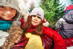Close up portrait of happy girls at winter forest Stock Images