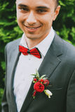 Close up portrait of happy groom near bush Royalty Free Stock Photo