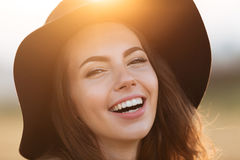 Close up portrait of a joyful girl in hat laughing. Close up portrait of a happy joyful girl in hat laughing outdoors Royalty Free Stock Photography