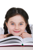 Close-up portrait happy little girl child with a book on a white Royalty Free Stock Photos