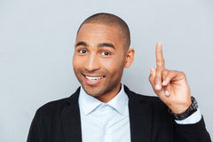 Close-up portrait of a happy man pointing finger up Royalty Free Stock Image