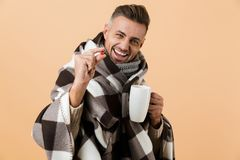 Close up portrait of a happy man wrapped in a blanket royalty free stock images