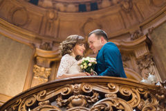 Close-up portrait of happy married couple embracing face-to-face on wooden balcony at old vintage house Stock Image