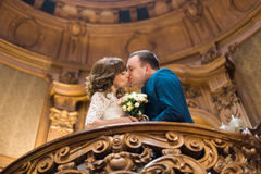 Close-up portrait of happy married couple kissing on wooden balcony at old vintage house Stock Image