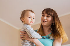 Close-up portrait of happy mother with adorable baby boy indoors Royalty Free Stock Photo