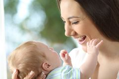 Happy mother looking at her baby royalty free stock photography
