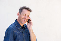 Close up happy older man talking on mobile phone. Close up portrait of happy older man talking on mobile phone royalty free stock image
