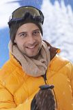 Close-up portrait of happy skier. Closeup winter portrait of happy male skier, looking at camera Royalty Free Stock Images